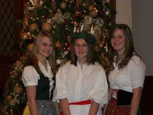 Hannah Seagren(center) was crowned St. Lucia during the annual festival of lights held at Thabor Lutheran Church, Wausa. She was honored with other high school senior girls Toni Lange (left) and Kayla Munter(right) at the event.